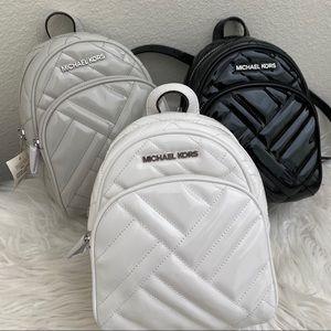 New Michael Kors abbey xs Minnie backpack Xbody